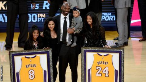 The Bryants during the game at which Kobe Bryant's number eight and 24 jerseys were retired