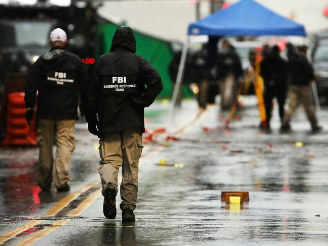 Police and FBI members continue to search the area around the scene of a bombing in the Chelsea neighbourhood of Manhattan.