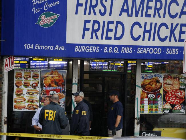 FBI agents gather at an apartment above a fried chicken shop believed to be the home of New York bomb suspect Ahmad Khan Rahami. Picture: Mel Evans
