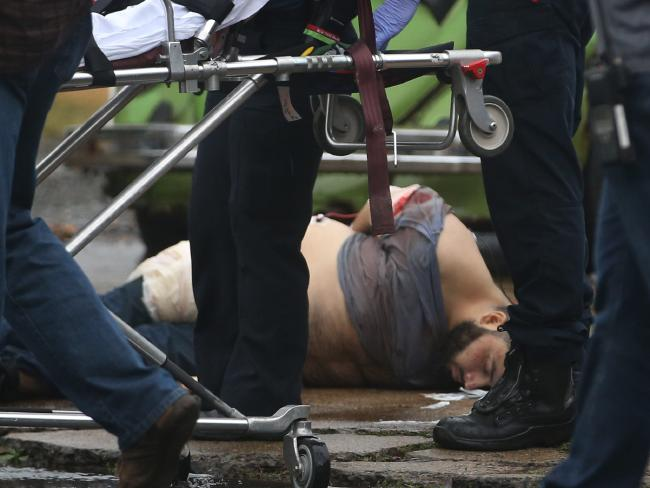 Ahmad Khan Rahami is taken into custody after a shootout with police Monday, September 19, 2016. Picture: Ed Murray/NJ Advance Media