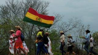 Protesters, including women and children, are marching from San Ignacio to Santa Cruz de la Sierra