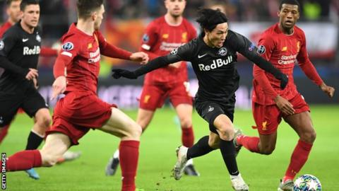 Takumi Minamino in action against Liverpool in this season's Champions League