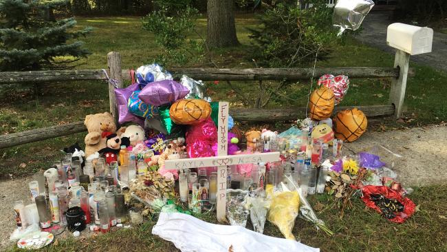 A memorial for Nisa Mickens and Kayla Cueva near where their bodies were found in Brentwood, New York. Picture: AP/Claudia Torrens