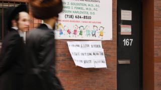 A sign posted outside a doctor's office in New York warns measles sufferers to stay away