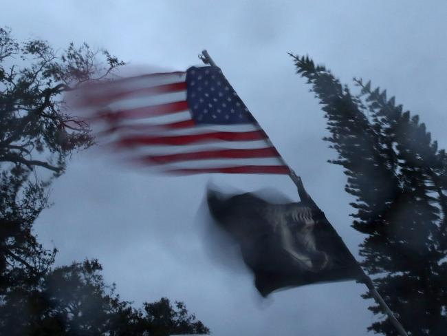 A US flag is whipped in the gale-force winds on Friday. Picture: Mark Wilson/Getty Images/AFP