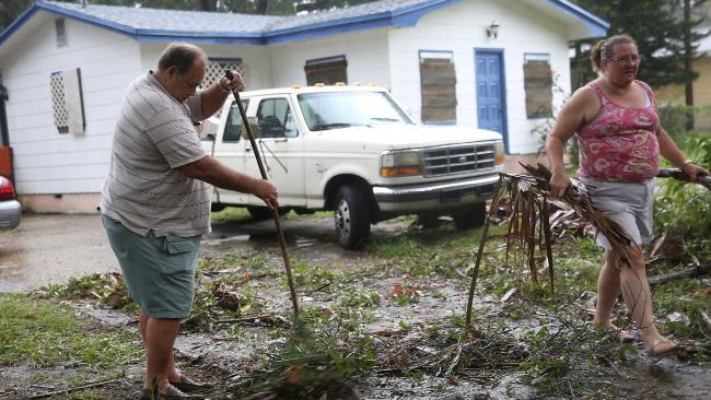 Locals from Fort Peirce, Florida clean up after Hurricane Matthew passed through the area on Friday. Picture: Joe Raedle/Getty Images/AFP.