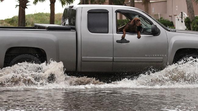 A truck ploughs through floodwaters in Jacksonville Beach, Florida. Picture: Mark Wilson/Getty Images/AFP