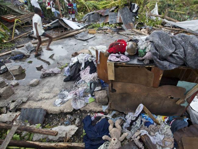 Personal items lie scattered outside homes destroyed by Hurricane Matthew in Les Cayes, Haiti. Picture: AP.