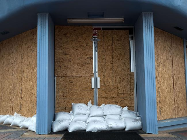 In lockdown. A storefront is barricaded with sandbags in Daytona Beach, Florida. Picture: Drew Angerer/Getty Images/AFP.