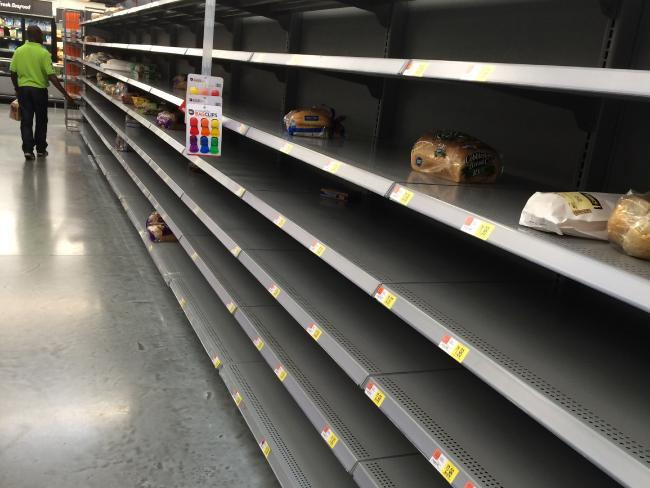 Shelves usually stocked with bread and bottled water are barren at the Walmart on W. Broward Blvd. in Fort Lauderdale, Florida. Picture: Emily Miller/Sun Sentinel via AP.