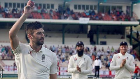 Mark Wood celebrates as he leaves the field