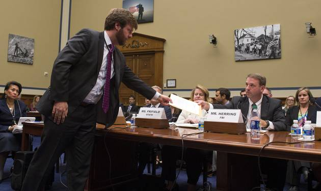 Jason Herring Acting Assistant Director for Congressional Affairs at the FBI is served a subpoena to provide the FBI's full investigative file during the House Oversight and Government Reform Committee hearing on classifications and redactions in F