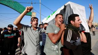Iraqi men carry the coffin of a demonstrator, who was killed during anti-government protests, at a funeral in Najaf, Iraq October 5, 2019