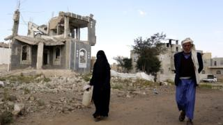 Yemenis walk past a destroyed building allegedly targeted by a previous Saudi-led airstrike, in Sanaa, Yemen, 08 December 2018.