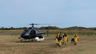New Zealand Police Search and Rescue and Disaster Victim Identification staff return to Whakatane Airport after conducting a search for bodies