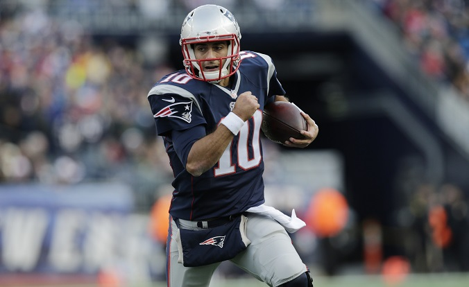 New England Patriots quarterback Jimmy Garoppolo  scrambles against the Buffalo Bills in the second half of an NFL football game Sunday Dec. 28 2014 in Foxborough Mass