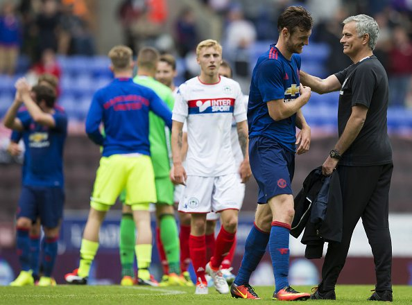 Manchester United's Portuguese manager Jose Mourinho congratulates Manchester United's English striker Will Keane following the pre-season friendly football match between Wigan Athletic and Manchester United at the DW stadium in Wigan northwest Engla