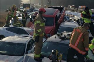 Damaged vehicles are seen after a crash on I-64 in York County, Virginia, December 22, 2019