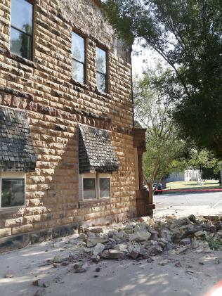 Sandstone bricks from the side of the historic Pawnee County Bank litter the footpath after an early morning earthquake in Oklahoma. Picture: Paul Hellstern/The Oklahoman via AP