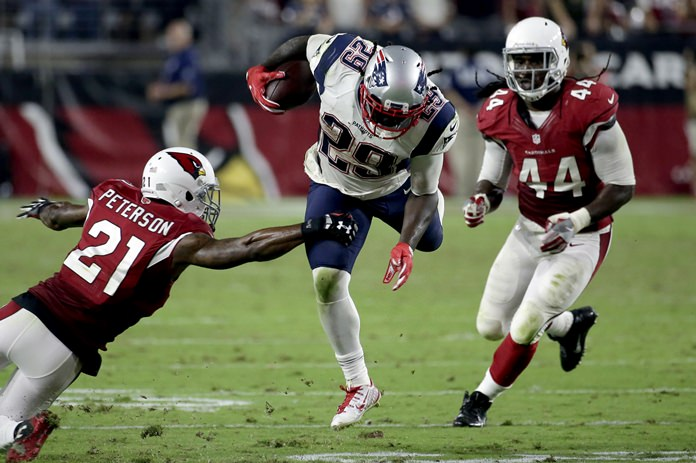 New England Patriots running back Le Garrette Blount is hit by Arizona Cardinals cornerback Patrick Peterson during the second half of their NFL football game Sunday Sept. 11 in Glendale Ariz