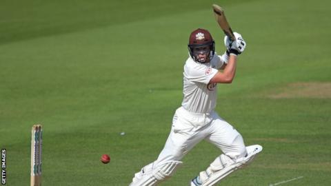 Surrey batsman Ollie Pope plays a shot against Hampshire