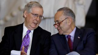 Senate Majority Leader Mitch McConnell and Senate Minority Leader Chuck Schumer talk during a ceremony in Washington, US, 25 October, 2017.