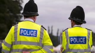 Police in hi-vis jackets