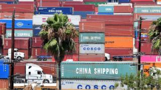 Container trucks arrive at the Port of Long Beach on 23 August 2019 in Long Beach, California
