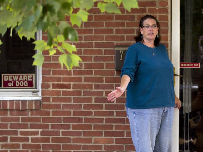 Harold Thomas Martin III's wife Debbie talks to reporters outside of her home in Glen Burnie, Maryland.