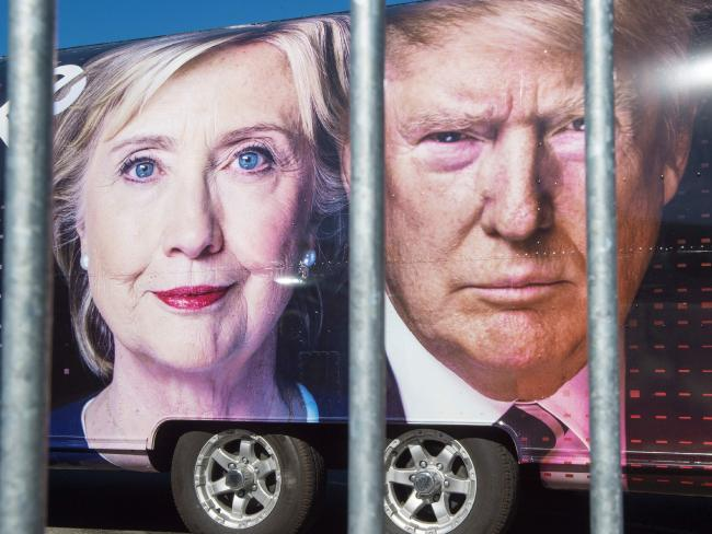 Democratic nominee Hillary Clinton and Republican nominee Donald Trump are seen on a CNN vehicle, behind a security fence, at Hofstra University, New York, the site of the first Presidential debate on September 26. Picture: AFP / Paul J Richards