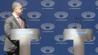 Acting Ukrainian President and Presidential candidate Petro Poroshenko looks at the empty Volodymyr Zelenskys podium during debate at the Olimpiyskiy Stadium in Kiev, Ukraine, 14 April 2019.
