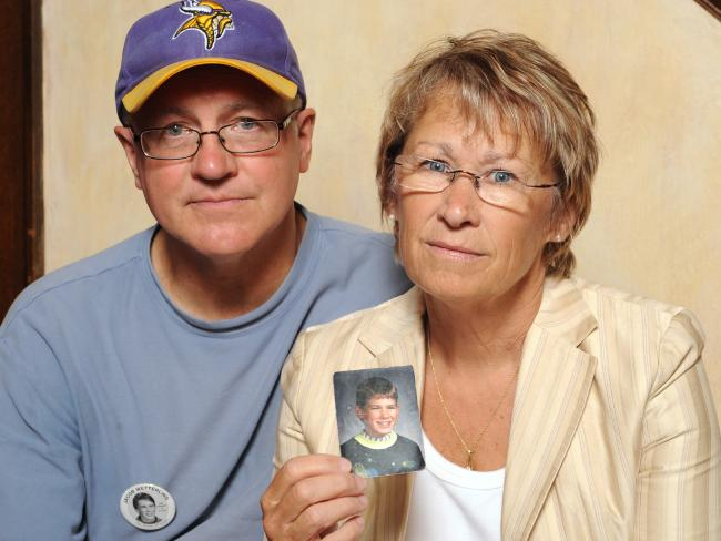 In this 2009 photo Patty and Jerry Wetterling show a picture of their son Jacob Wetterling. Picture: AP