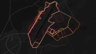 Red heat lines are arrayed neatly in the pattern of roads and streets on a dark black map