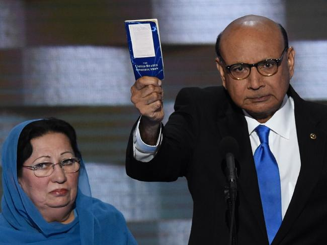 Khizr Khan, with wife Ghazala, holding his personal copy of the US Constitution, suggesting Donald Trump read it. Picture: AFP