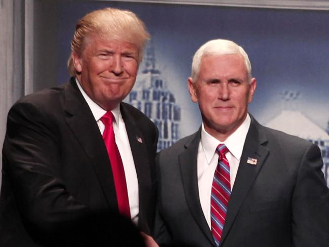 Republican presidential nominee Donald Trump and his running mate Mike Pence (left) don't see eye-to-eye on a range of issues. Picture: Bill Pugliano/Getty Images/AFP