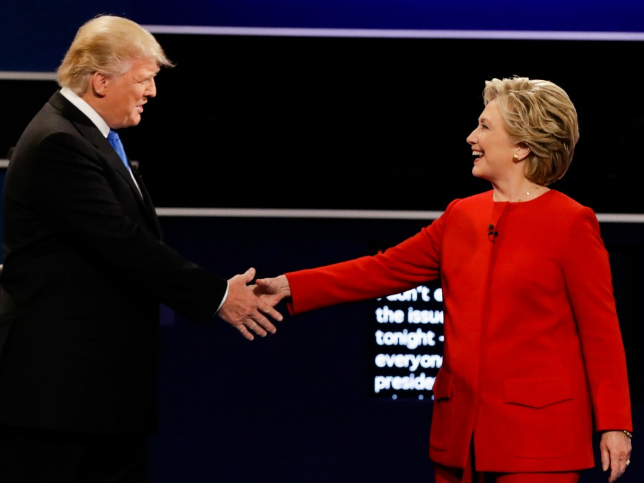 While Donald Trump had the advantage of his hand facing the audience Hillary Clinton counteracted that by extending her arm fully the pundits say