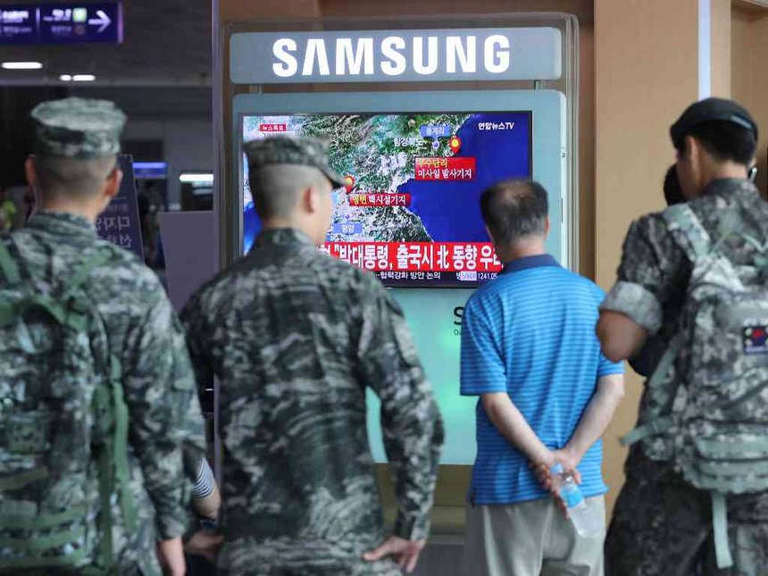 South Korean soldiers and passenger watch a TV broadcasting a news report on Seismic activity produced by a suspected North Korean nuclear test at a railway station in Seoul South Korea
