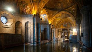 A view inside the flooded St Mark's Basilica in Venice during an exceptional high tide, 13 November 2019