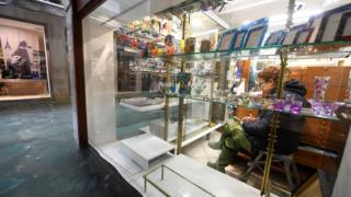 Flood and woman in shop, 15 Nov 19
