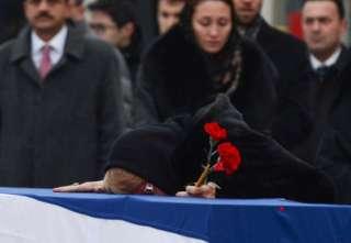 Andrei Karlov's widow Marina weeps on his coffin