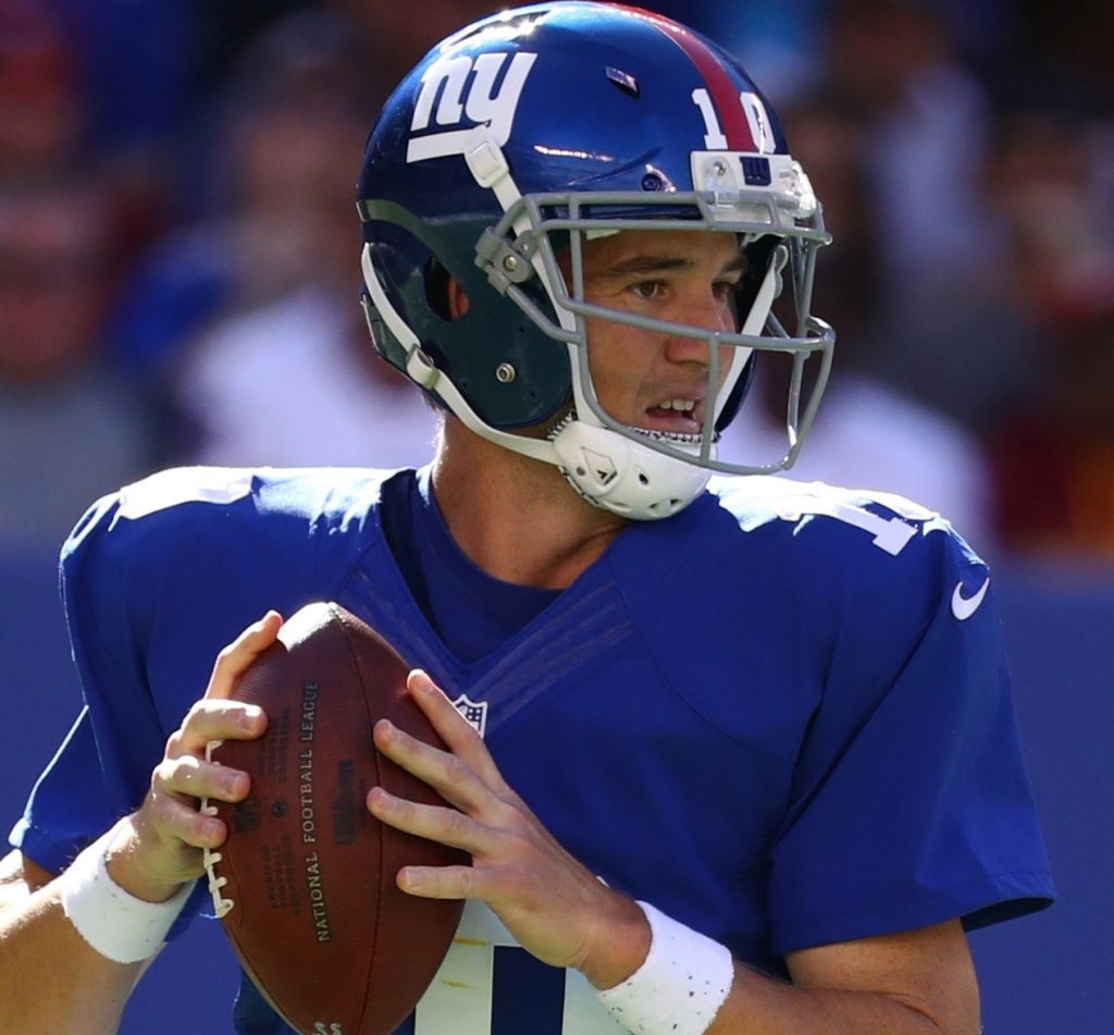 EAST RUTHERFORD NJ- SEPTEMBER 25 Eli Manning #10 of the New York Giants drops back to pass against the Washington Redskins during their game at Met Life Stadium