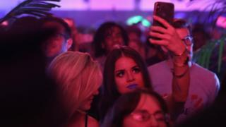 A young woman filming at TikTok's launch party