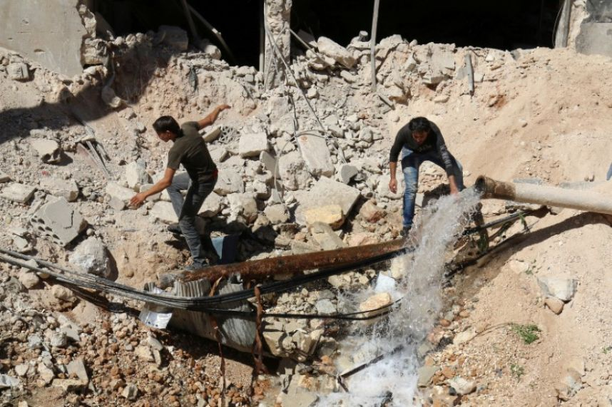 Battle rages near Aleppo, air onslaught continues