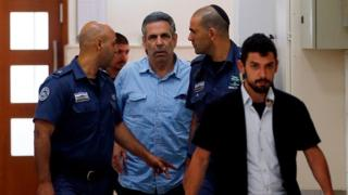 File photo showing Gonen Segev being led into court in Jerusalem on 5 July 2018