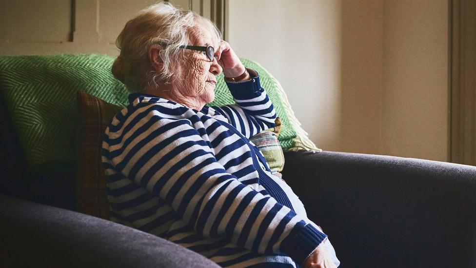 Pensioner watching TV