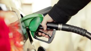 Hand at petrol pump