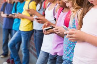 children holding phones