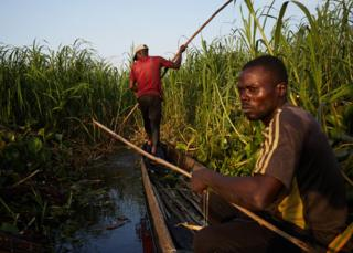 Alphonsi Ndoma (Wearing red t-shirt) and Guylain Mudjombe check their nets