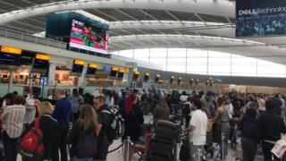 Holidaymakers face delays at Heathrow Airport
