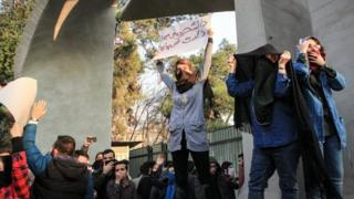 Iranian students clash with riot police during an anti-government protest around the University of Tehran, Iran, 30 December 2017.